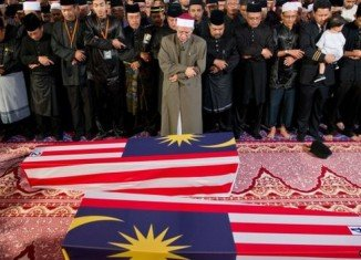 The bodies of 20 Malaysian victims of Flight MH17 that crashed in Ukraine last month have arrived in Kuala Lumpur