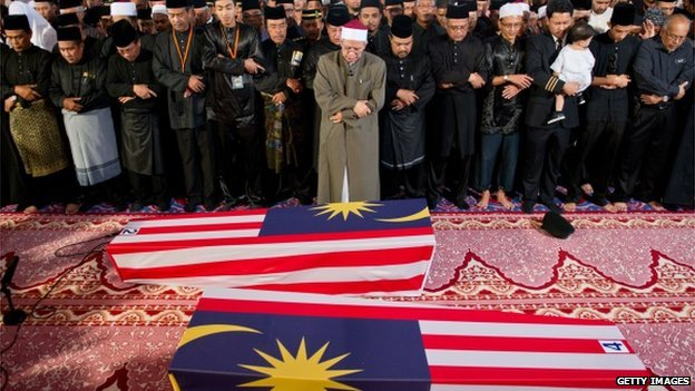 The bodies of 20 Malaysian victims of Flight MH17 that crashed in Ukraine last month have arrived in Kuala Lumpur photo