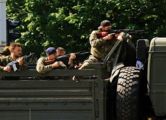 Ukraine military claims rockets and mortars hit vehicles moving refugees from the Luhansk area killing dozens of civilians