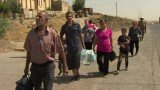 Up to a quarter of Iraq's Christians are reported to be fleeing after Islamic militants seized Qaraqosh