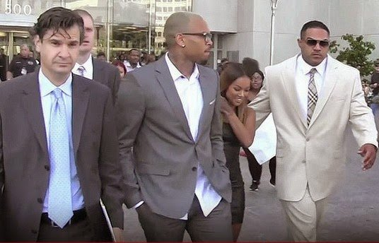 Chris Brown has pleaded guilty to punching Parker Adams outside W Hotel in Washington DC in October 2013