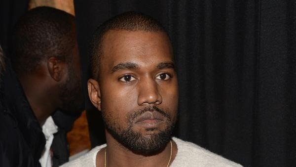 Kanye West stopped his concert at the Qantas Credit Union Arena in Sydney and repeatedly asked a wheelchair-user to stand up