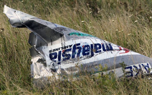 Malaysia Airlines flight MH17 broke up in mid-air after being hit by numerous objects that pierced the plane at high speed