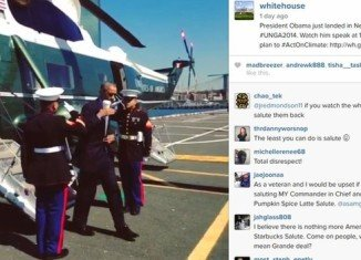 Many Americans took to Twitter to condemn President Barack Obama after he appeared to salute Marine Corps guards holding a coffee cup in his right hand