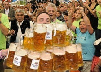 Oliver Struempfel set a new world record in beer-mug-carrying at the Gillemoos festival in Abensberg