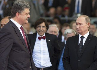 Petro Poroshenko has agreed with Vladimir Putin by phone on a cease-fire process for eastern Ukraine
