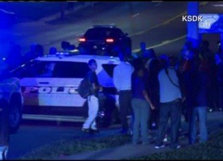 The officer was shot in the arm, according to local broadcaster KSDK, but the circumstances are not known