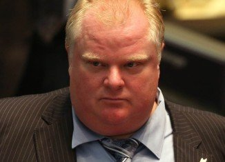 Toronto Mayor Rob Ford has been hospitalized with a tentative diagnosis of a tumor after suffering months of abdominal pain