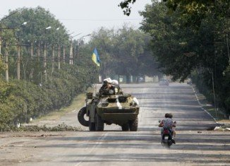 Ukraine will start the withdrawal of heavy weaponry from separatist rebel lines in the east
