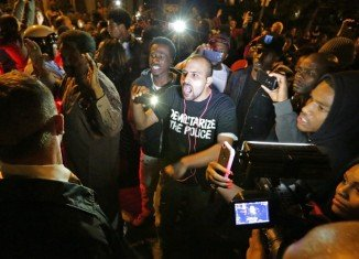 Angry crowds on Shaw streets after an off-duty police officer fatally shot a black teenager
