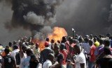 Angry protesters in Burkina Faso have set fire to parliament