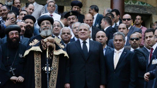 Egypt's PM Ibrahim Mahlab and Pope Tawadros II attended the opening ceremony at the Coptic Christian Church in Cairo