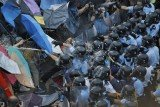 Hong Kong protesters have retaken streets in the Mong Kok district cleared by the authorities just a few hours earlier