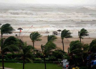 Hundreds of thousands of people are evacuated as Cyclone Hudhud pounds the eastern Indian coast