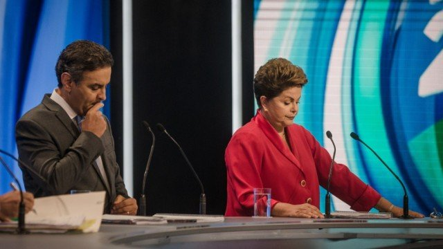 Leftist President Dilma Rousseff faces centrist Aecio Neves in the second run-off round of Brazil's presidential election