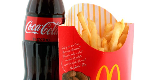 McDonald's and Coca-Cola have posted sharply lower profits for Q3 2014