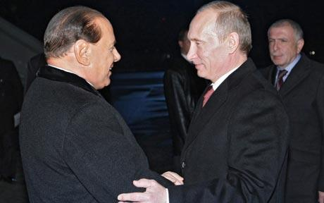 President Vladimir Putin has paid a late-night visit to former Italian PM Silvio Berlusconi during ASEM summit in Milan