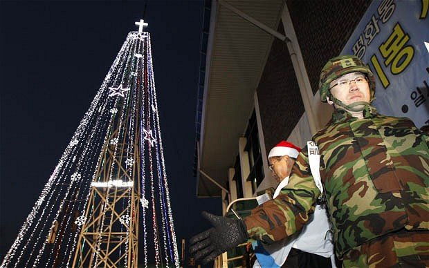 South Korea has taken down a tower used to construct a Christmas tree at the border with North Korea photo