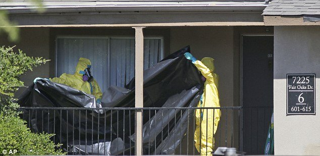 The flat in Dallas where Thomas Eric Duncan lived before being isolated is being cleaned by hazardous materials specialists