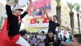 Tunisians are voting to elect the country's first full parliament under a new constitution passed earlier this year