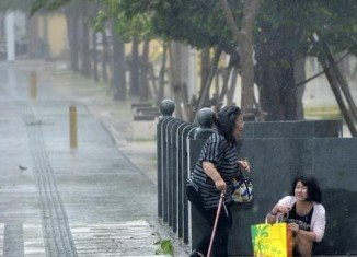 Typhoon Phanfone is bringing many parts of Japan to a standstill with heavy wind and rain as it heads towards Tokyo