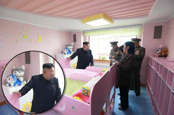 Kim Jong-un has been pictured smoking a cigarette while visiting a baby home and orphanage in Pyongyang