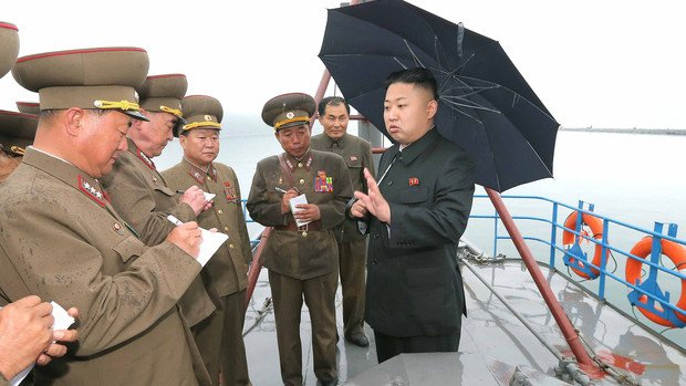 Kim Jong-un pictured walking without a cane at an army meeting, following speculation about his health