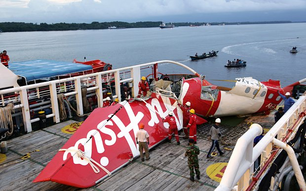 AirAsia fuselage recovery suspended