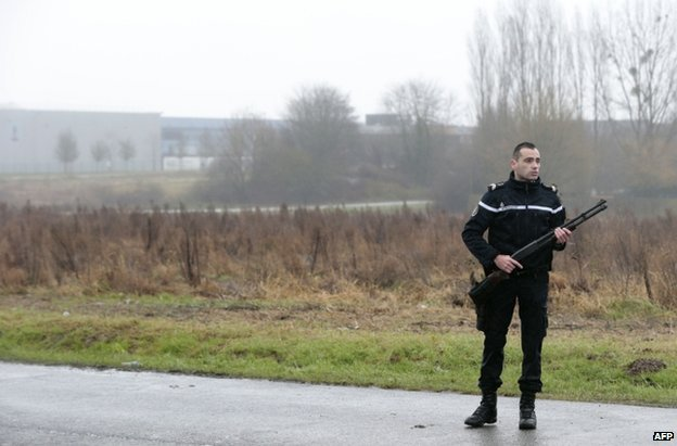 Charlie Hebdo suspects surrounded