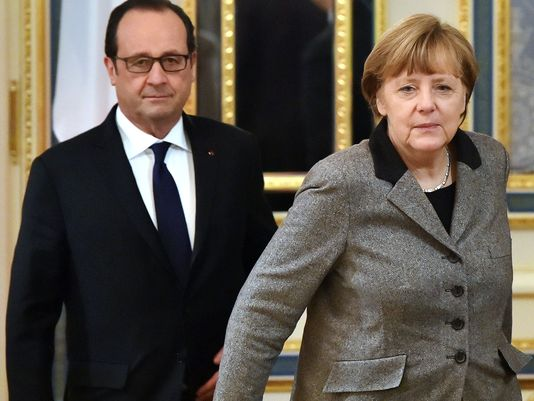 Angela Merkel and Francois Hollande in Moscow peace talks