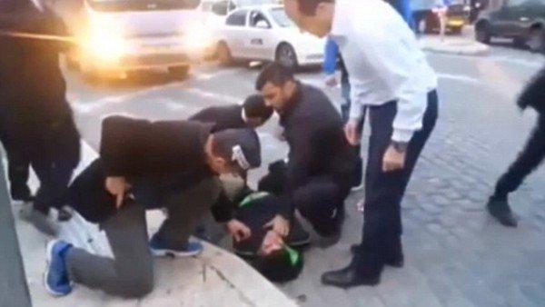 Jerusalem Mayor Nir Barkat wrestles attacker