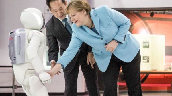 Angela Merkel and humanoid robot ASIMO