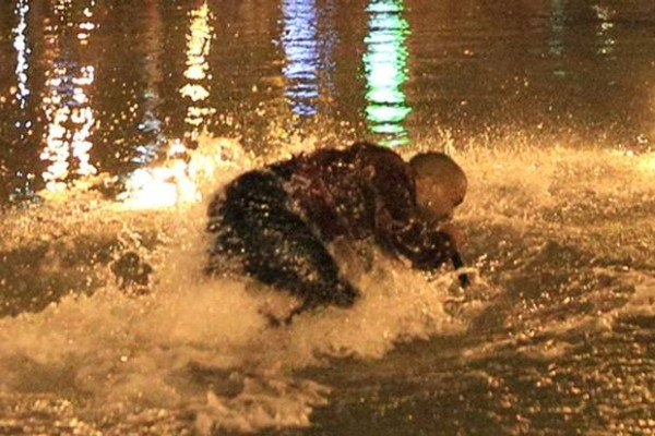 Kanye West jumps into lake during Armenia concert