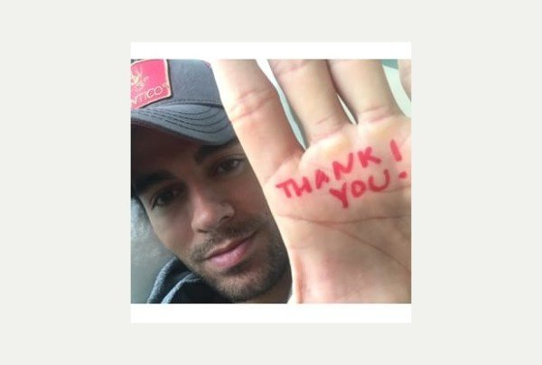 Enrique Iglesias after reconstructive hand surgery