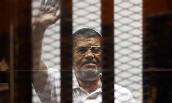 Egypt's former president Mohamed Morsi inside a glass cage during his trial in Cairo earlier this ye