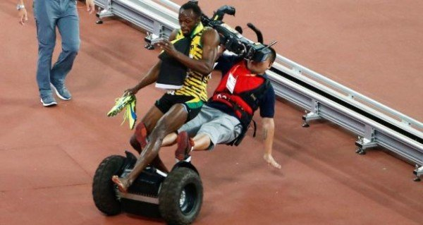 Usain Bolt and segway riding cameraman