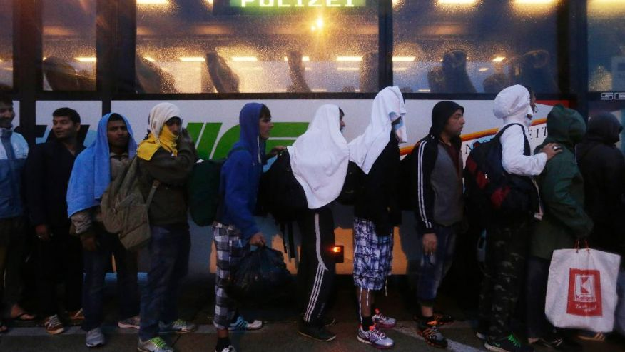 hungary migrants cross austrian border after budapest
