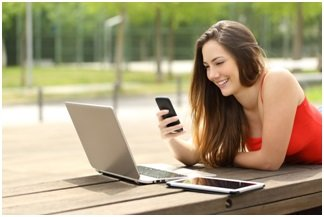 Woman-using-computer-and-mobile-devices-image