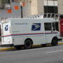 USPS Suspends Policy Changes Amid Postal Voting Controversy